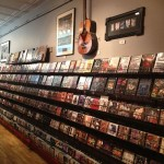 Music CD's, DVD's collector's Box sets, VHS tapes and music art and collectables line our walls